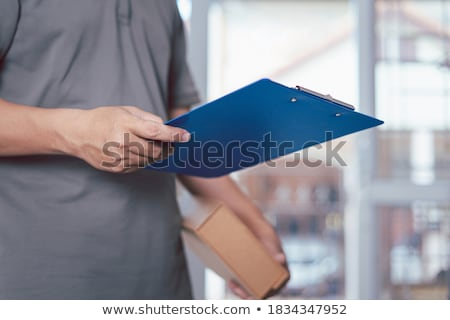 online shopping logistic hand with check list Stock photo © yupiramos
