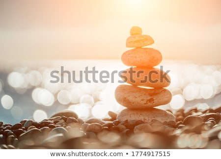 Pirámide mar guijarros soleado arena playa Foto stock © karandaev