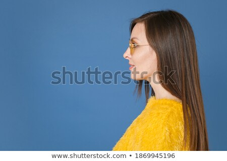 Smiling brunette girl wearing blue fur. Stock photo © NeonShot