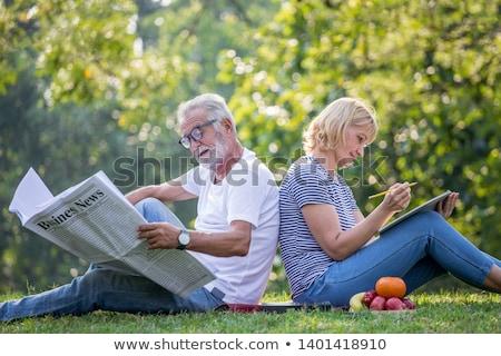 Gelukkig senior vrouw lezing dagboek najaar Stockfoto © dolgachov