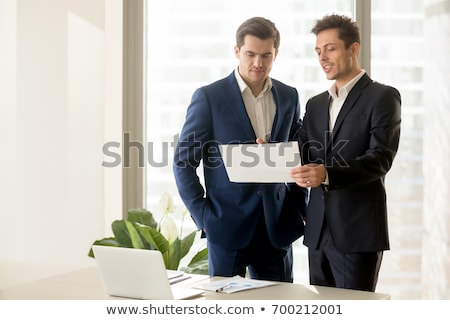 businessman talk about profit stock photo © qiun