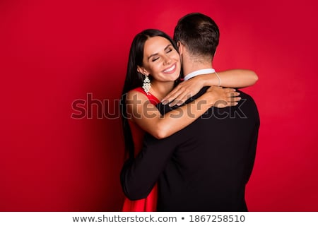 Girl with red hair embraces guy behind stock photo © Paha_L