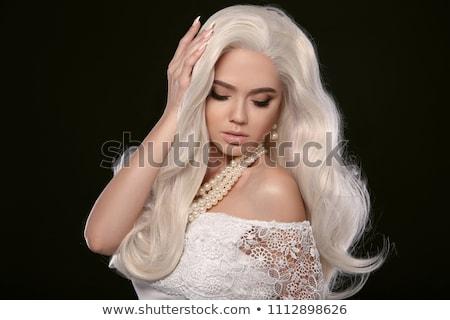 Szőke nő fekete mosolyog női nő haj Stock fotó © lovleah