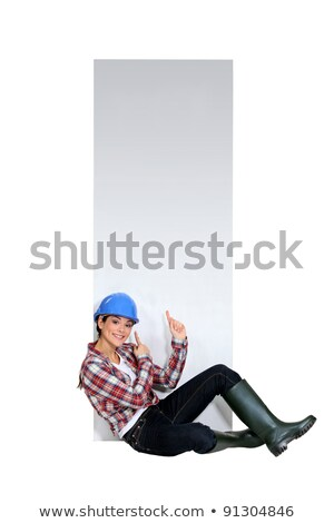female builder sat by blank poster stock photo © photography33