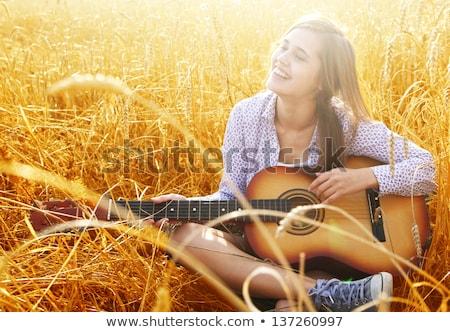 Genç kadın kuru ot yığını mavi gökyüzü doğa çiftlik yuva Stok fotoğraf © pekour