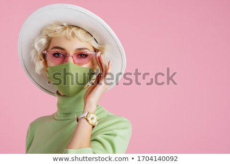 attractive woman wearing a green hat stock photo © photography33