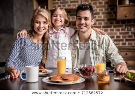 Little girl and mother about to eat pancakes for breakfast stock photo © photography33