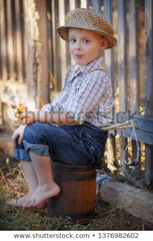 小 少年 座って 草 花 顔 ストックフォト © AndreyKr