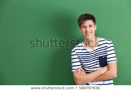 Smiling boy on a green background Stock photo © michey
