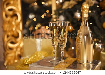 Decorative lighted wine bottles and glasses. Stock photo © justinb