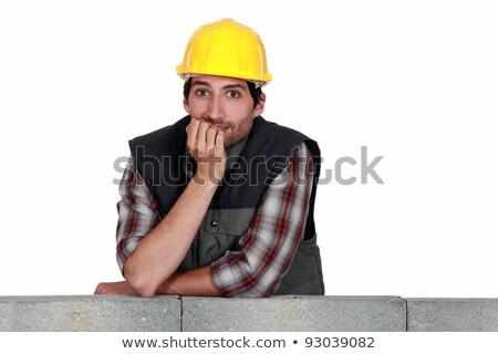 A mason biting his nails. Stock photo © photography33