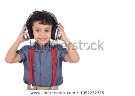 Boy putting headphones on Stock photo © photography33