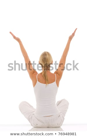 a young caucasian woman dressed in white sitting cross-legged doing yoga Stock photo © ambro