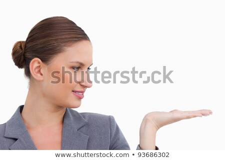 Close up of tradeswoman holding her palm up against a white background Stock photo © wavebreak_media