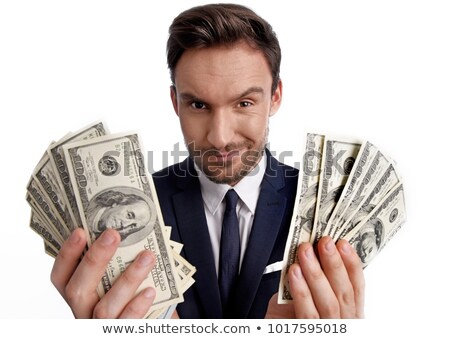 Young businessman with a pile of cash Stock photo © photography33