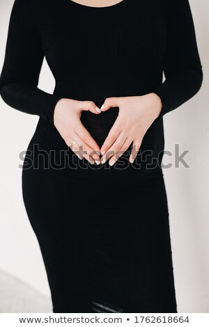 fashion woman holding her dress Stock photo © feedough