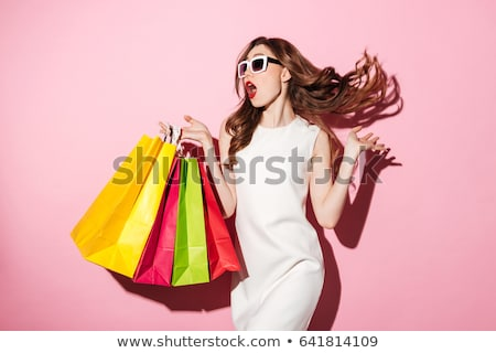 Brunette woman in white dress posing on pink Stock photo © dash