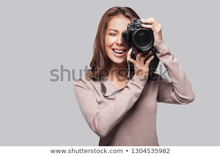 woman photographer with camera stock photo © redpixel