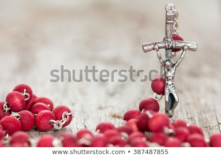Rosary on old wooden background Stock photo © nessokv