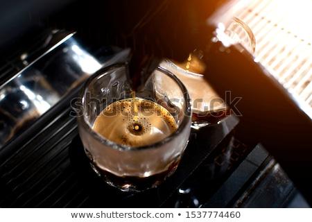 Doubler espresso femme au-dessus séance bureau Photo stock © Kzenon