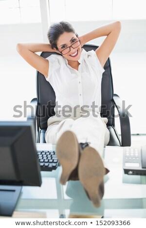 молодые брюнетка деловая женщина очки расслабиться ног Сток-фото © sebastiangauert
