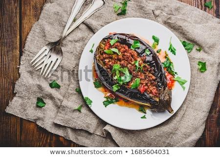 piatto · melanzane · ripieno · formaggio · tavolo · in · legno - foto d'archivio © marimorena