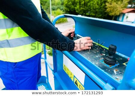 grúa · conductor · posando · enorme · móviles · tecnología - foto stock © kzenon