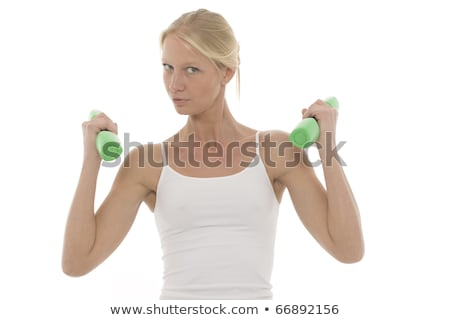 Stock photo: portrait of a young caucasian woman who trains with dumbbells in hand