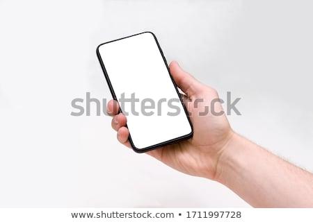 Obraz mężczyzna ręce smartphone Zdjęcia stock © deandrobot