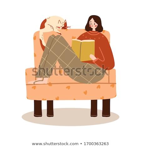 Jóvenes feliz mujer lectura libro sillón Foto stock © deandrobot
