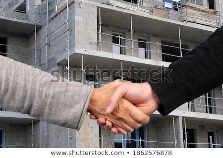 Architectural Handshaking in front of building Stock photo © adamr
