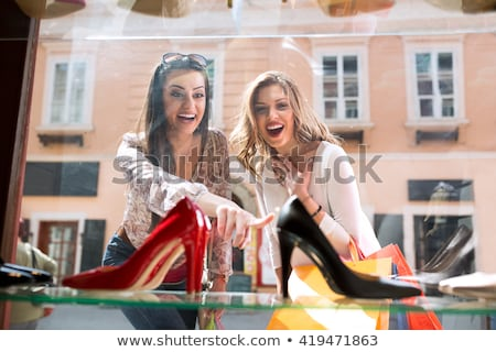 Stock photo: Smiling woman looking at shoes