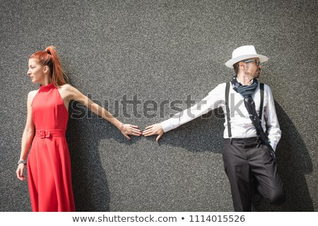 fashion couple looking away while touching hands stock photo © feedough