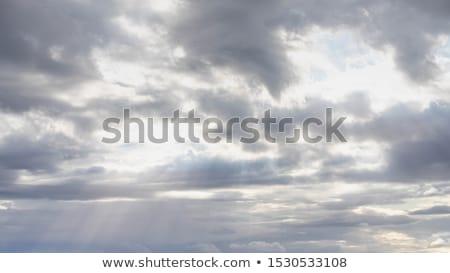Image of sun shine through rain cloud Stock photo © stoonn