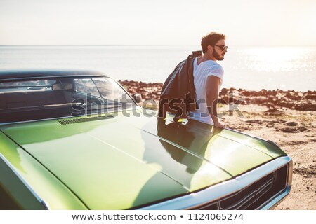 handsome man standing near sea stock photo © deandrobot