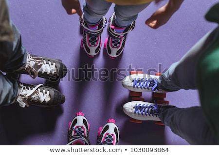 boy standing on roller skates stock photo © paha_l