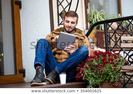 Lächelnd bärtigen Mann Sitzung Veranda Eingang Stock foto © deandrobot