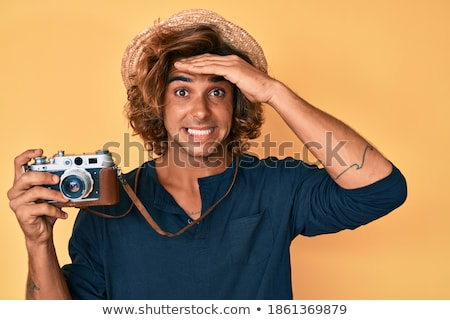 stressed male photographer holding photo camera stock photo © deandrobot