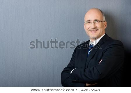 bald senior businessman wearing glasses Stock photo © feedough