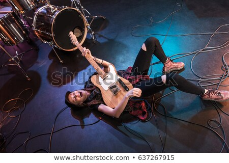 Stock photo: Rock star with guitar, high angle view