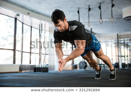 a fit man doing clapping hands push ups stock photo © wavebreak_media
