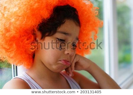 Terkedilmiş çocuk palyaço saç peruk üzücü Stok fotoğraf © zurijeta