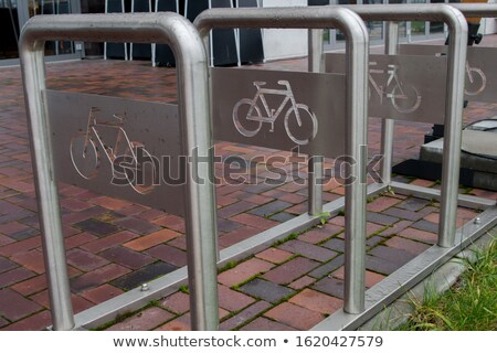 parking of bicycles on sidewalk stock photo © zhekos