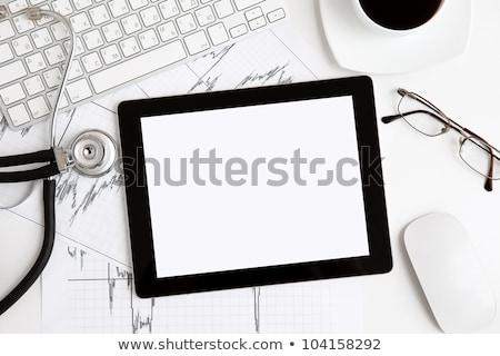 tablet computer with blank screen on doctors office desk stock photo © stevanovicigor