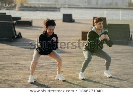 Sportive girl runs on the waterfront Stock photo © bezikus