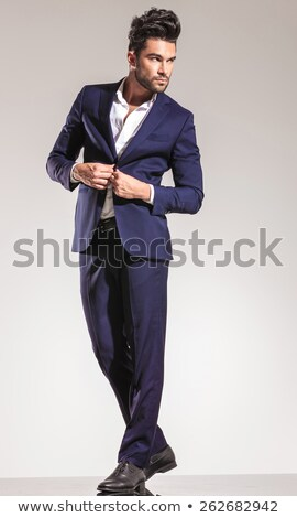 side view of a young business man closing his coat Stock photo © feedough