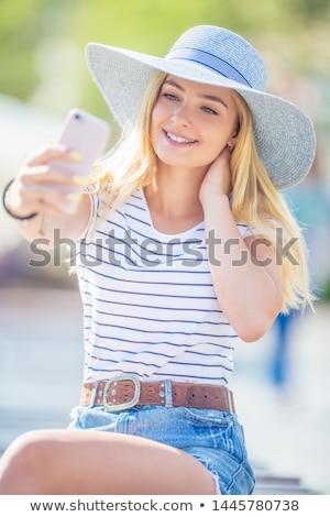 Fashionable girl doing selfie. Stock photo © NeonShot