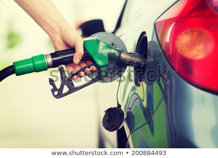 работник заполнение вверх топлива автомобилей азиатских Сток-фото © RAStudio