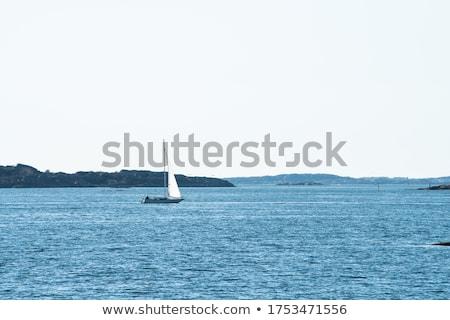 Lonely Sailboat on Horizon Stock photo © zhekos