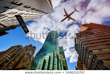 Airplane over the city Stock photo © orla